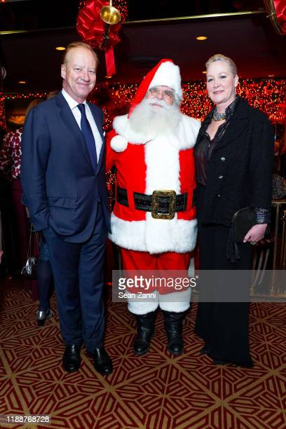 Will Denton, Santa Claus and Sara Dodd attend Anne Hearst McInerney, Jay McInerney And George Farias Host Christmas Cheer at Doubles Club on December...