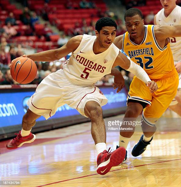 Will DiIorio of the Washington State Cougars drives past Brandon Barnes of the Cal State Bakersfield Roadrunners during the game at Beasley Coliseum...