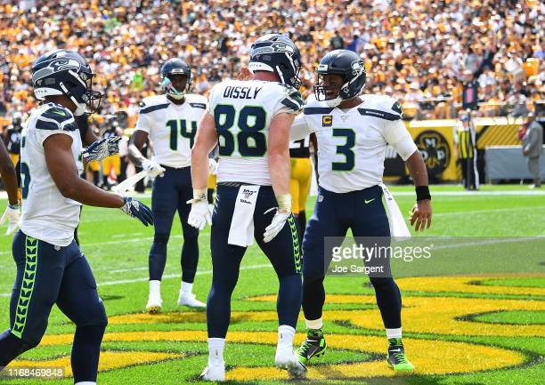 Will Dissly of the Seattle Seahawks celebrates his touchdown with Russell Wilson during the second quarter against the Pittsburgh Steelers at Heinz...