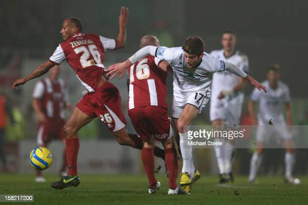Will Evans of Hereford United loses out to Russ Penn and Chris Zebroski of Cheltenham Town during the FA Cup with Budweiser Second Round Replay match...
