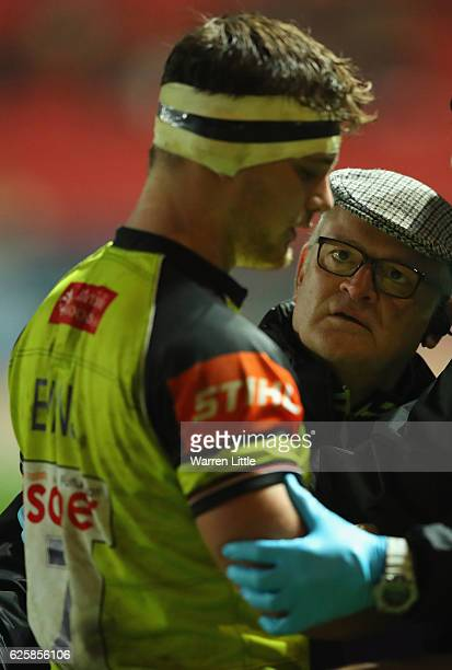 Will Evans of Leicester Tigers is checked out by the team doctor during the Aviva Premiership match between Bristol Rugby and Leicester Tigers at...