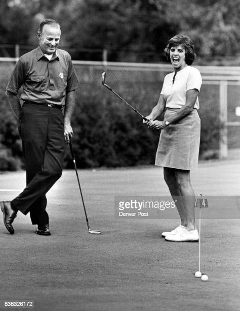 Will F Nicholson Jr and Mrs Ormand Birkland share a laugh on the putting green of the Denver Country Club site of the Curtis Cup Credit The Denver...