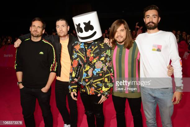 Will Farquarson and Dan Smith of Bastille Marshmello Chris Wood and Kyle J Simmons of Bastille attend the MTV EMAs 2018 at the Bilbao Exhibition...