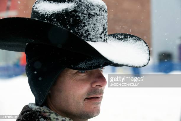 Will Faust of Saratoga Wyoming watches the 71st annual Leadville Ski Joring weekend competition under the snow on March 3 2019 in Leadville Colorado...