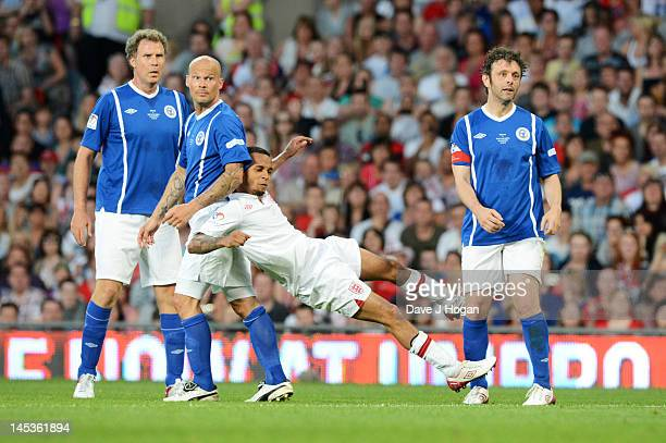 Will Ferrall Freddie Ljungberg Aston Merrygold and Michael Sheen attend Soccer Aid 2012 in aid of Unicef at Old Trafford on May 27 2012 in Manchester...