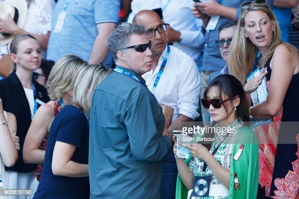 Will Ferrell and his wife Viveca Paulin watch the second round match between Caroline Wozniacki of Denmark and Jana Fett of Croatia on day three of...