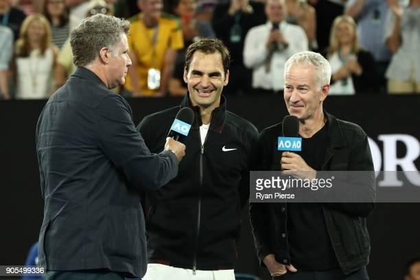 Will Ferrell and John McEnroe interview Roger Federer of Switzerland after Federer won his first round match against Aljaz Bedene of Slovenia on day...