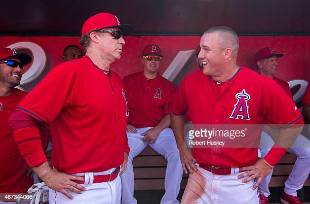 Will Ferrell and Mike Trout of the Los Angeles Angels of Anaheim laugh in the dugout during the spring training game against the Chicago Cubs on...