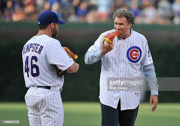 Will Ferrell and Ryan Dempster of the Chicago Cubs eat pizza on the pitcher's mound before Ferrell threw out a ceremonial first pitch before the game...