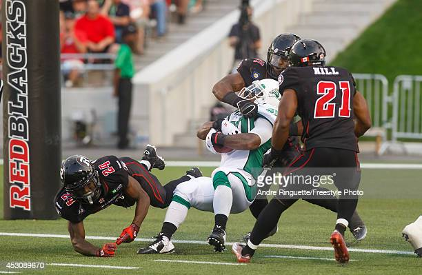 Will Ford of the Saskatchewan Roughriders spins his way to a touchdown against Jerrell Gavins Jasper Simmons and TJ Hill of the Ottawa Redblacks...