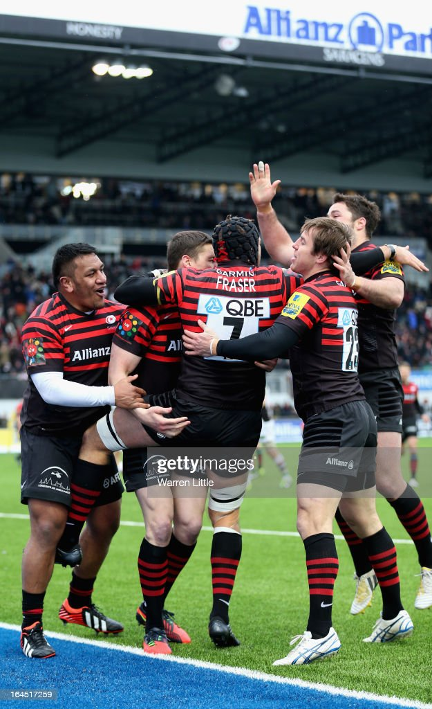 Will Fraser of Saracens is congratulated after scoring a try during the Aviva Premiership match between Saracens and Harlequins at Allianz Park on March 24, 2013 in Barnet, England.
