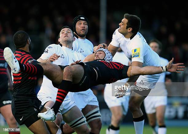 Will Fraser of Saracens looses his footing challenging for the arial ball with Ryan Shortland of Newcastle Falcons during the Aviva Premiership match...