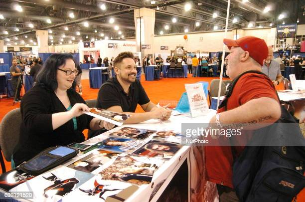 Will Friedle signs an autograph for a fan of boy meets world at WizardWorld Comic Con in Philadelphia PA onJune 2 2017