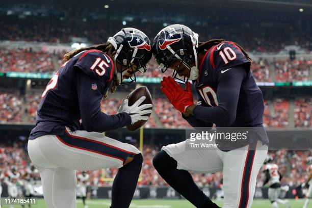 Will Fuller and DeAndre Hopkins of the Houston Texans celebration a touchdown reception against the Atlanta Falcons in the first quarter at NRG...