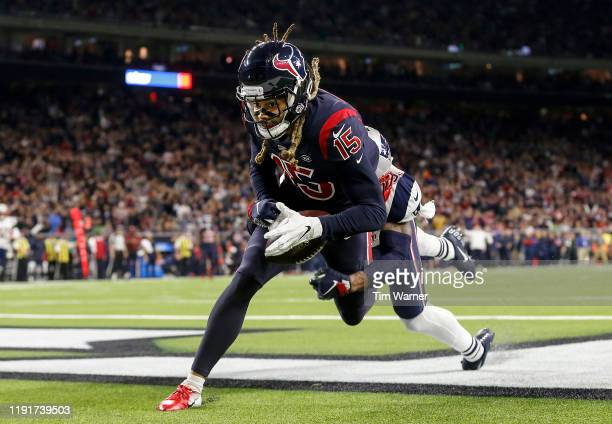 Will Fuller of the Houston Texans cannot make the reception in the end zone in the second half against the New England Patriots at NRG Stadium on...