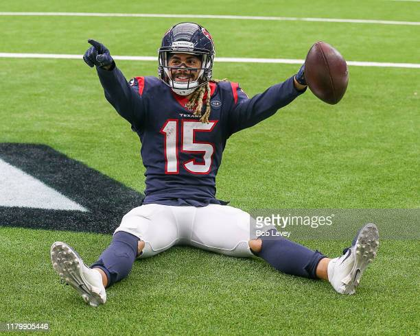 Will Fuller of the Houston Texans catches a pass for a touchdown as Desmond Trufant of the Atlanta Falcons is unable to make the tackle during the...
