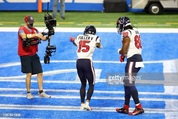 Will Fuller of the Houston Texans celebrates a touchdown during the second half of a game against the Detroit Lions at Ford Field on November 26,...