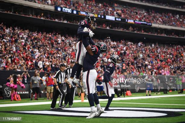 Will Fuller of the Houston Texans celebrates with teammates after scoring a touchdown in the first quarter against the Atlanta Falcons at NRG Stadium...