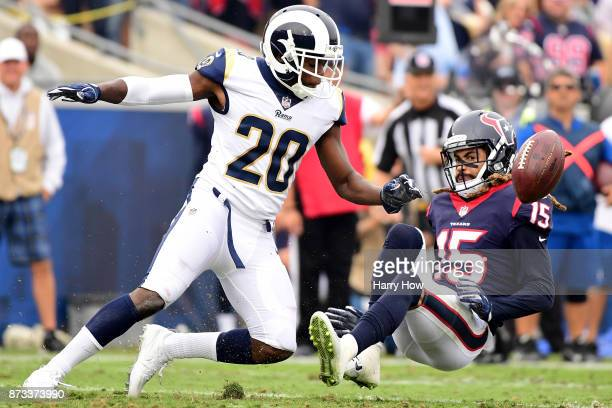 Will Fuller of the Houston Texans drops the pass while being guarded by Lamarcus Joyner of the Los Angeles Rams during the second quarter of the game...