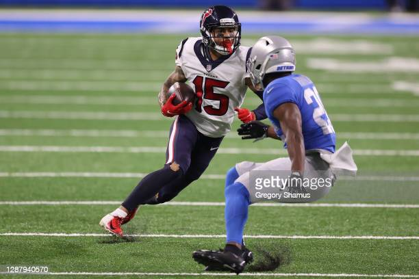 Will Fuller of the Houston Texans is pursued by Duron Harmon of the Detroit Lions during the second half of a game at Ford Field on November 26, 2020...