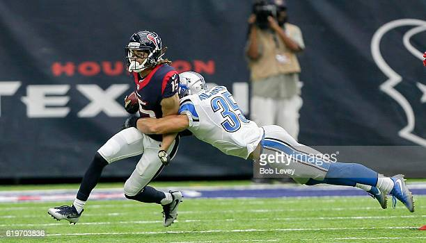 Will Fuller of the Houston Texans is tackled by Miles Killebrew of the Detroit Lions at NRG Stadium on October 30, 2016 in Houston, Texas.