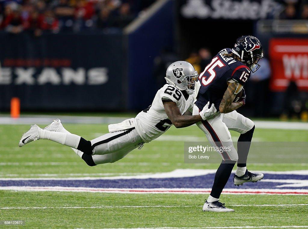 Will Fuller #15 of the Houston Texans is tackled from behind by David Amerson #29 of the Oakland Raiders in their AFC Wild Card game at NRG Stadium on January 7, 2017 in Houston, Texas. (Photo by Bob Levey/Getty Images)'n