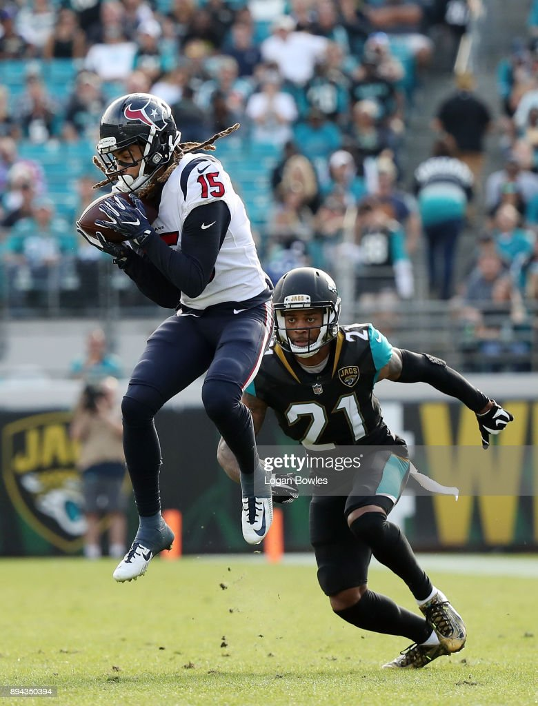 Will Fuller #15 of the Houston Texans leaps for the football in front of A.J. Bouye #21 of the Jacksonville Jaguars during the first half of their game at EverBank Field on December 17, 2017 in Jacksonville, Florida.