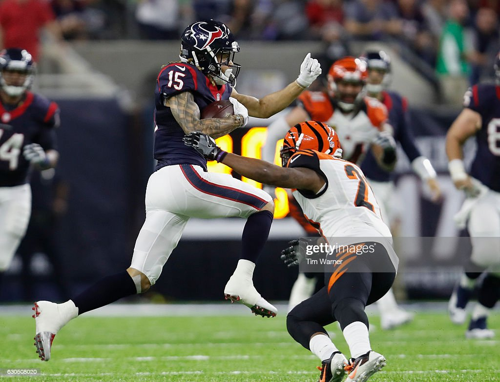 Will Fuller #15 of the Houston Texans leaps past Dre Kirkpatrick #27 of the Cincinnati Bengals in the fourth quarter at NRG Stadium on December 24, 2016 in Houston, Texas.