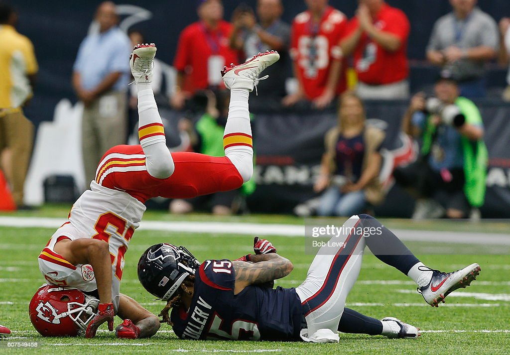 Will Fuller #15 of the Houston Texans makes a catch as he is tackled by Phillip Gaines #23 of the Kansas City Chiefs in the first quarter at NRG Stadium on September 18, 2016 in Houston, Texas.