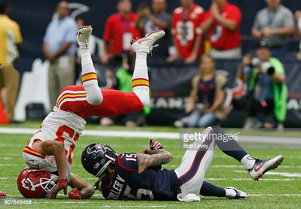Will Fuller of the Houston Texans makes a catch as he is tackled by Phillip Gaines of the Kansas City Chiefs in the first quarter at NRG Stadium on...