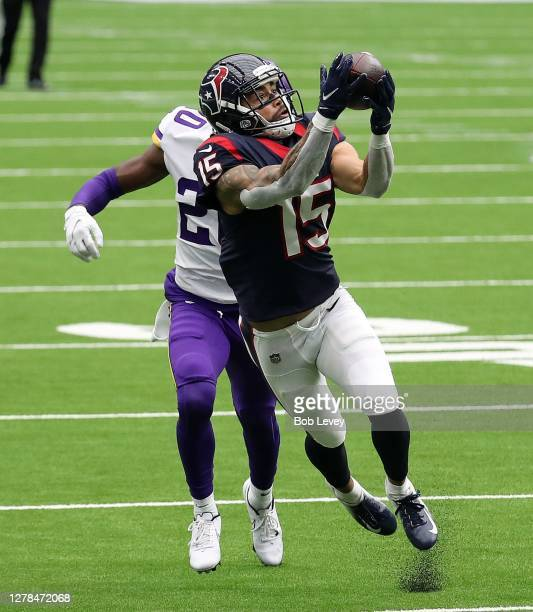 Will Fuller of the Houston Texans makes a catch as Jeff Gladney of the Minnesota Vikings defends during the third quarter at NRG Stadium on October...