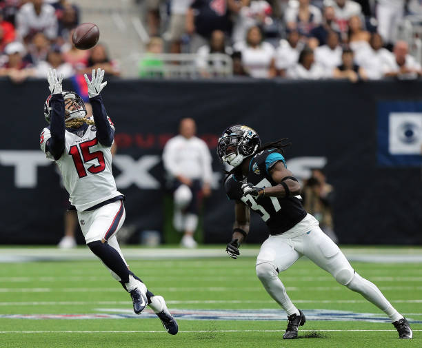 Will Fuller of the Houston Texans makes a catch in the second quarter as he beats Tre Herndon of the Jacksonville Jaguars on the play at NRG Stadium...