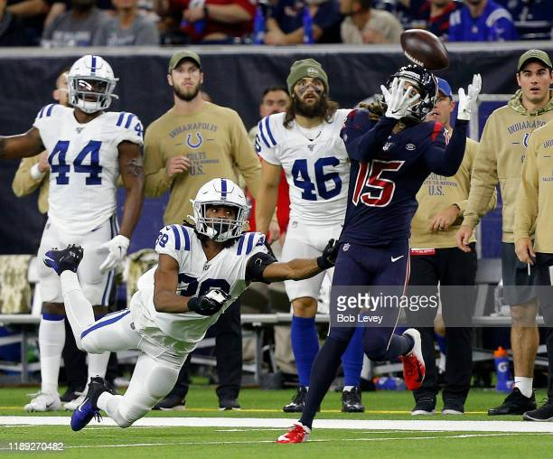 Will Fuller of the Houston Texans makes a diving catch as he slips behind Marvell Tell of the Indianapolis Colts during the second half at NRG...