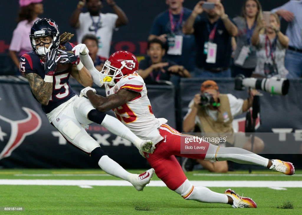 Will Fuller #15 of the Houston Texans makes a reception for a touchdown as he slips behind Terrance Mitchell of the Kansas City Chiefs in the fourth quarter at NRG Stadium on October 8, 2017 in Houston, Texas.
