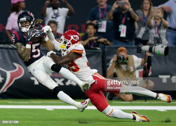 Will Fuller of the Houston Texans makes a reception for a touchdown as he slips behind Terrance Mitchell of the Kansas City Chiefs in the fourth...