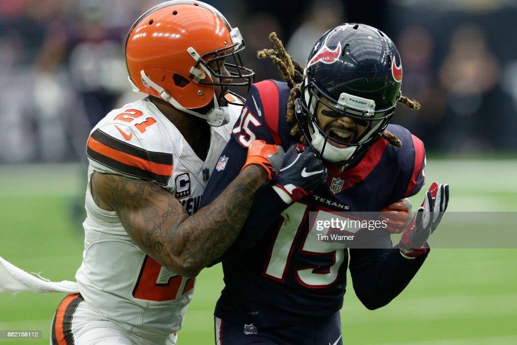 Will Fuller #15 of the Houston Texans reacts after dropping a pass in the second half defended by Jamar Taylor at NRG Stadium on October 15, 2017 in Houston, Texas.
