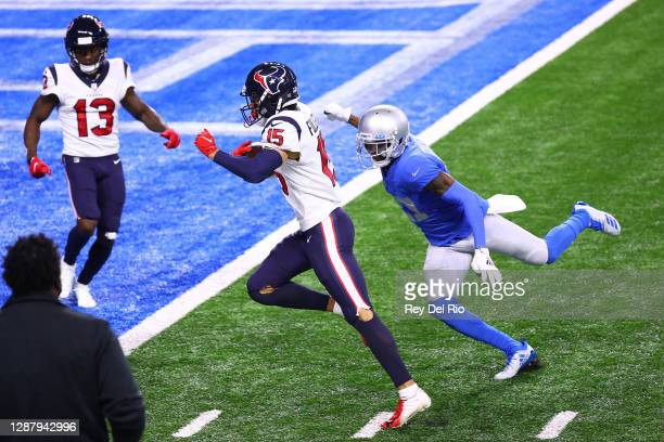 Will Fuller of the Houston Texans scores in front of Justin Coleman of the Detroit Lions during the second half of a game at Ford Field on November...