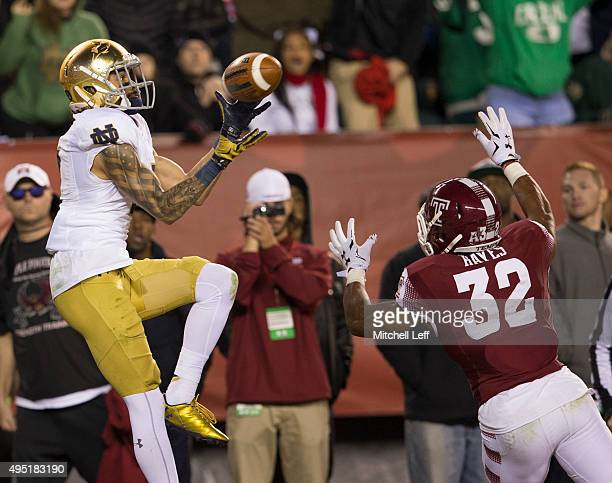 Will Fuller of the Notre Dame Fighting Irish catches the game winning touchdown over Will Hayes of the Temple Owls in the fourth quarter on October...