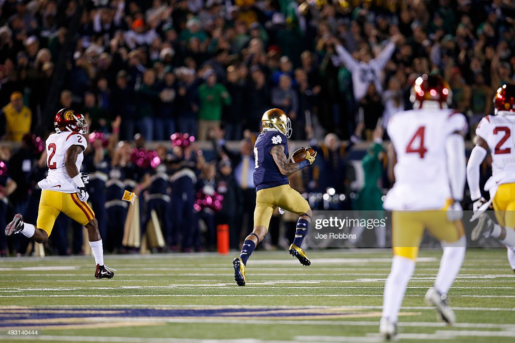 Will Fuller #7 of the Notre Dame Fighting Irish makes a 75-yard touchdown reception behind Adoree' Jackson #2 of the USC Trojans in the first quarter of the game at Notre Dame Stadium on October 17, 2015 in South Bend, Indiana.