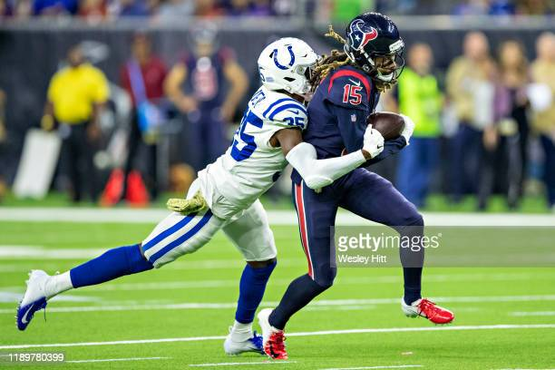 Will Fuller V of the Houston Texans catches a pass and is tackled by Pierre Desir of the Indianapolis Colts at NRG Stadium on November 21, 2019 in...