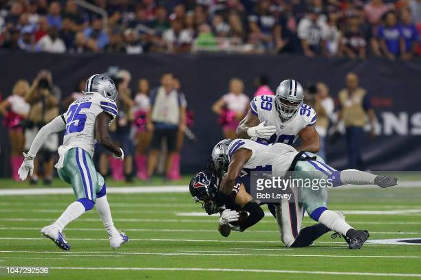Will Fuller V of the Houston Texans is tackled by Jaylon Smith of the Dallas Cowboys in the first quarter at NRG Stadium on October 7 2018 in Houston...