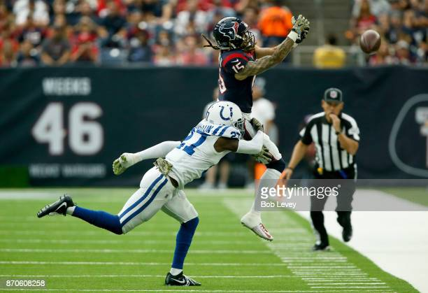 Will Fuller V of the Houston Texans misses the pass defended by Nate Hairston of the Indianapolis Colts in the second quarter at NRG Stadium on...