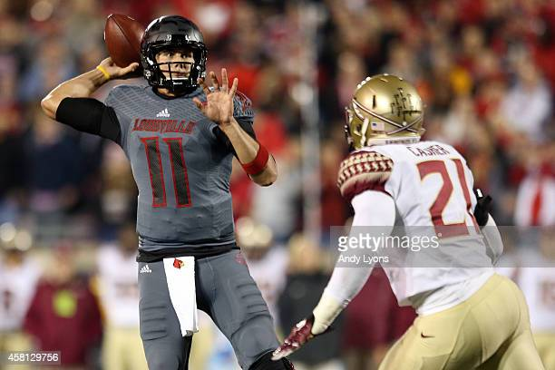 Will Gardner of the Louisville Cardinals throws a 11 yard touchdown pass to Gerald Christian in the second quarter against the Florida State...
