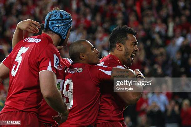 Will Genia and Digby Ioane of the Reds celebrate a try during the 2011 Super Rugby Grand Final match between the Reds and the Crusaders at Suncorp...