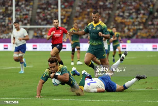 Will Genia of Australia breaks scores his sides fifth try during the Rugby World Cup 2019 Group D game between Australia and Uruguay at Oita Stadium...