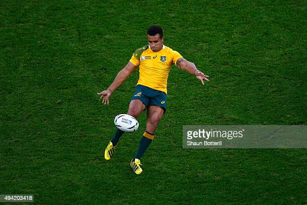 Will Genia of Australia kicks up field during the 2015 Rugby World Cup Semi Final match between Argentina and Australia at Twickenham Stadium on...