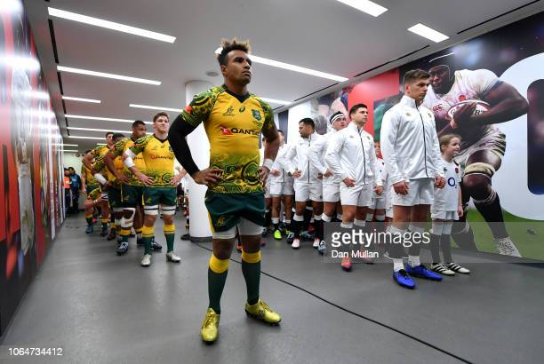 Will Genia of Australia leads the Australian team out on achieving his 100th cap before the Quilter International match between England and Australia...