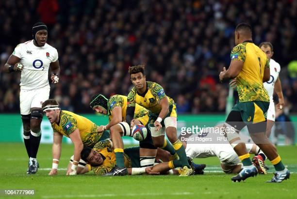 Will Genia of Australia offloads the ball during the Quilter International match between England and Australia at Twickenham Stadium on November 24,...