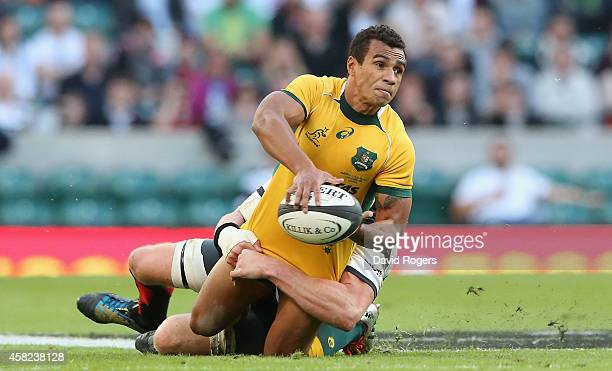 Will Genia of Australia passes the ball as Adam Thomson tackles during the Killick Cup match between the Barbarians and Australian Wallabies at...