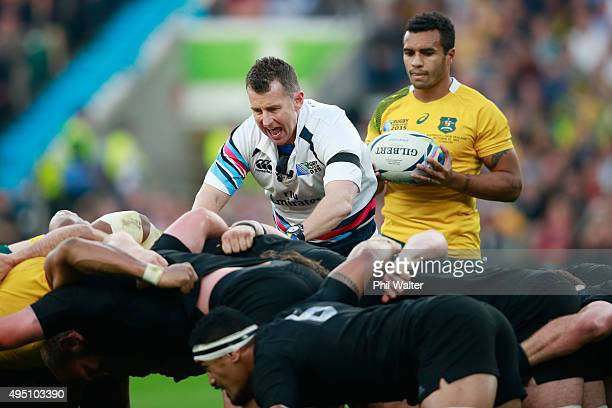 Will Genia of Australia prepares to put the ball into the scrum as referee Nigel Owens of Wales sets the two packs during the 2015 Rugby World Cup...